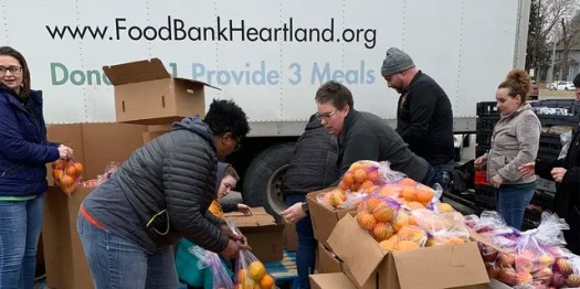 Food Bank for the Heartland volunteers and staff distribute food at an emergency drive-up mobile pantry in Omaha during the COVID-19 pandemic. (Food Bank for the Heartland)