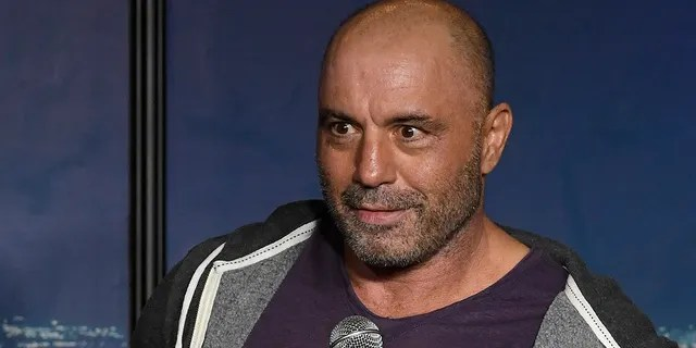 """Joe Rogan's podcast, """"The Joe Rogan Experience,"""" has debuted on Spotify, but episodes featuring controversial guests are missing. (Photo by Michael S. Schwartz/Getty Images)"""