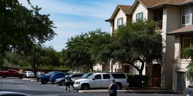 A woman who lost custody of her two children killed them both and her own mother before killing herself at the Sedona Ranch apartments in San Antonio, police said. (Billy Calzada/The San Antonio Express-News via AP)