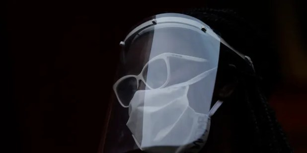 A woman wearing a face mask and shield to protect from the spread of the new coronavirus in Duque de Caxias, Brazil, Wednesday, June 10, 2020. (AP Photo/Silvia Izquierdo)  Coronavirus: Face shields offer less protection for others than regular masks, study finds – Fox News 13 AP20162785063440