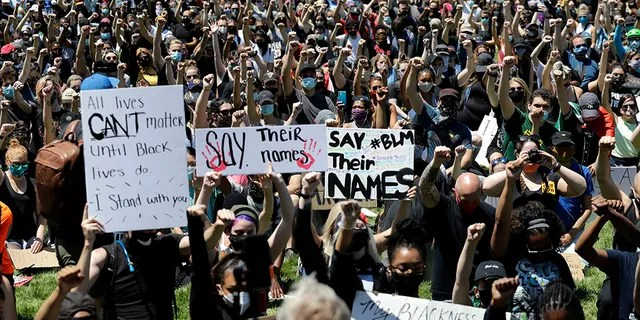 Thousands of people gather for the Chicago March for Justice in honor of George Floyd at Chicago's Union Park Saturday, June 6, 2020, in Chicago. (AP Photo/Nam Y. Huh)