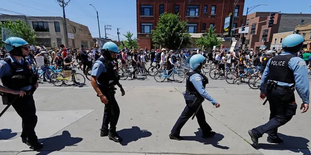Demonstrators march during the Chicago March for Justice in honor of George Floyd in Chicago, June 6, 2020. (AP Photo/Nam Y. Huh)