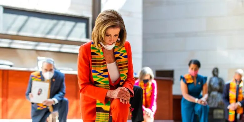 House Speaker Nancy Pelosi of California, center, and other members of Congress kneel and observe a moment of silence at the Capitol's Emancipation Hall, Monday, June 8, 2020, on Capitol Hill in Washington, reading the names of George Floyd and others killed during police interactions. (AP Photo/Manuel Balce Ceneta)