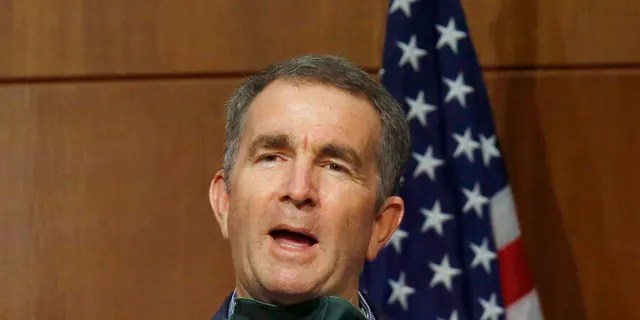 Virginia Gov. Ralph Northam answers a question during a press briefing inside the Patrick Henry Building in Richmond, V. Tuesday, June 9, 2020. (Bob Brown/Richmond Times-Dispatch via AP)
