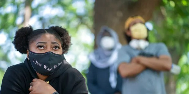 Cierra Hurst, from Brooklyn Park, Minnesota, who grew up in Minneapolis, attends a meeting at North Commons Park in Minneapolis on how to address issues with the Minneapolis Police Department.