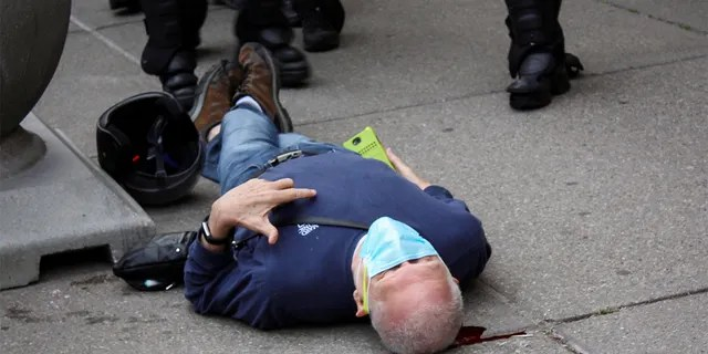 Martin Gugino, a 75-year-old protester, lays on the ground after he was shoved by two Buffalo, N.Y., police officers, June 4, 2020. (Reuters)