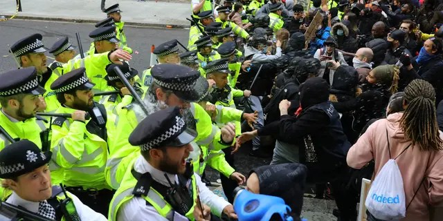 Police clash with protesters during a Black Lives Matter protest rally in Westminster, London, on Sunday. (AP/PA)