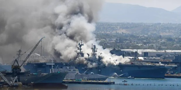 Smoke rises from the USS Bonhomme Richard at San Diego Naval Base on Sunday, July 12, 2020 in San Diego after an explosion and fire Sunday aboard the ship at San Diego Naval Base.