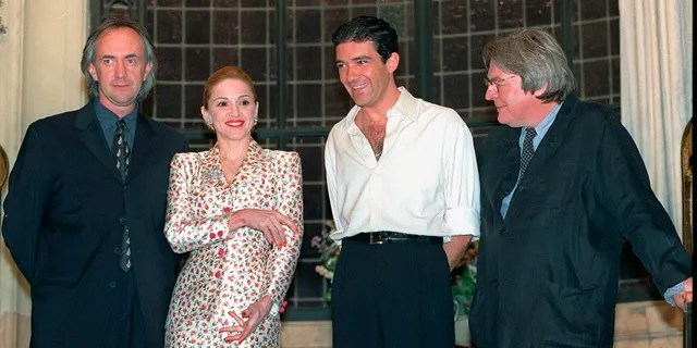 "FILE - British actor Jonathan Pryce, from left, American actress-singer Madonna and Spanish actor Antonio Banderas appear at a news conference about the musical film ""Evita"" with British director Alan Parker in Buenos Aires on Feb. 6, 1996. Parker, whose movies included ""Bugsy Malone,"" ""Midnight Express"" and ""Evita,"" has died at the age of 76. A statement from the director's family says Parker died Friday in London after a long illness. (AP Photo/Daniel Muzio, File)"