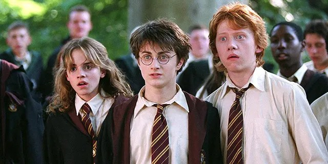 From left to right: Emma Watson as Hermione Granger, Daniel Radcliffe as Harry Potter, and Rupert Grint as Ron Weasley in the 'Harry Potter' franchise.