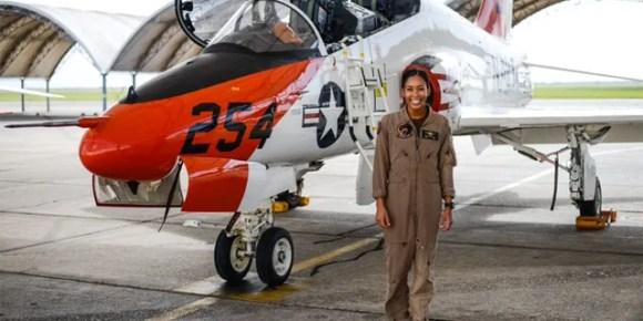 Student Naval Aviator Lt. j.g. Madeline Swegle stands alongside a T-45C Goshawk training aircraft following her final flight to complete the undergraduate Tactical Air (Strike) pilot training syllabus, July 7, 2020 (U.S. Navy photo by Lt.j.g. Luke Redito/Released)