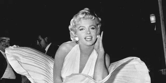 """Marilyn Monroe poses over the updraft of New York subway grating while in character for the filming of """"The Seven Year Itch"""" in Manhattan on Sept. 15, 1954. (Associated Press)"""