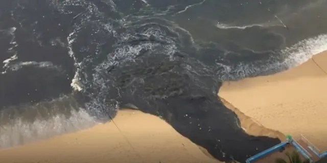 """""""Black water"""" flows into Acapulco Bay in Acapulco, Guerrero, Mexico June 25, in this picture obtained from social media."""