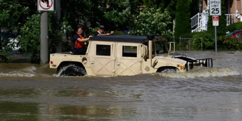 Philadelphia firefighters driving through a flooded neighborhood in the aftermath of Tropical Storm Isaias on Tuesday.