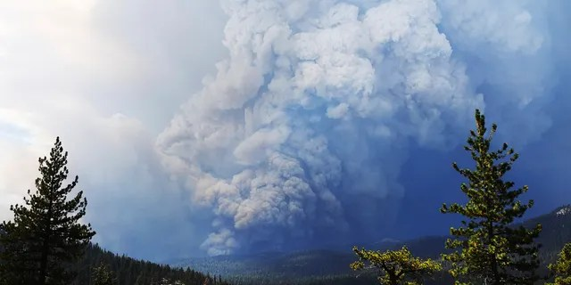 Huntington Lake is seen in the foreground as the Creek Fire burns in the distance Saturday, Sept. 5, 2020, about 35 miles northeast of Fresno, Calif.