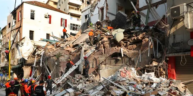 Chilean and Lebanese rescuers search in the rubble of a building that was collapsed in last month's massive explosion, after getting signals there may be a survivor under the rubble, in Beirut, Lebanon, Sept. 3.