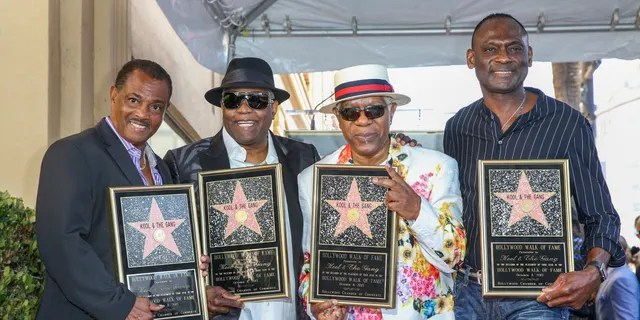 FILE - Robert 'Kool' Bell, from left, Ronald 'Khalis' Bell, Dennis 'DT' Thomas and George Brown attend a ceremony honoring Kool & The Gang with a star on the Hollywood Walk of Fame on October 8 2015, in Los Angeles.  (Photo by Rich Fury / Invision / AP, FILE)