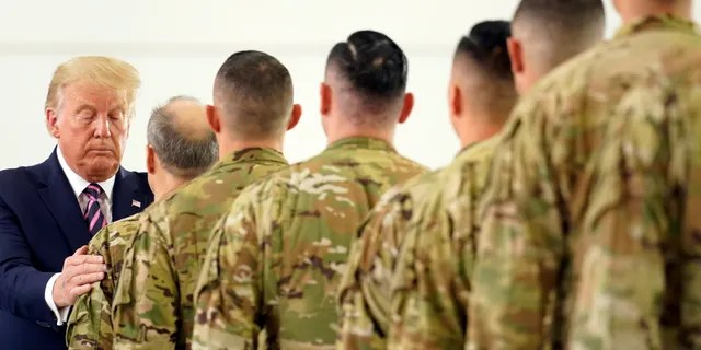 President Donald Trump participates in a ceremony recognizing the California National Guard at Sacramento McClellan Airport, in McClellan Park, Calif., Monday, Sept. 14, 2020, after being briefed on wildfires. (AP Photo/Andrew Harnik)
