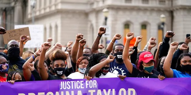 Black Lives Matter protesters march, Friday, Sept. 25, 2020, in Louisville. (AP Photo/Darron Cummings)