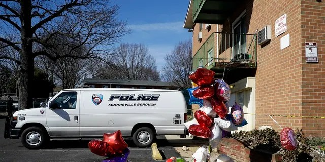 A makeshift memorial is seen outside the Robert Morris Apartments in Morrisville, Pa. Shana Decree, 47, and Dominique Decree, 21, were sentenced in Bucks County Court after entering guilty but mentally ill pleas to five counts of first-degree murder. (AP Photo/Matt Slocum, File)