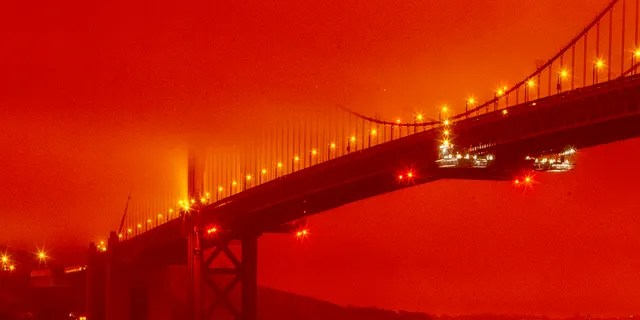 The Golden Gate Bridge is pictured on Wednesday morning in San Francisco, amid a smoky, orange hue caused by the ongoing wildfires. (Frederic Larson via AP)