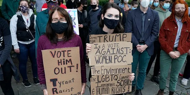 Protesters listen to speakers at a rally near the debate hall, Tuesday, Sept. 29, 2020, in Cleveland. The first presidential debate between Republican candidate President Donald Trump and Democratic candidate and former Vice President Joe Biden is being held in Cleveland on Tuesday. (AP Photo/Tony Dejak)