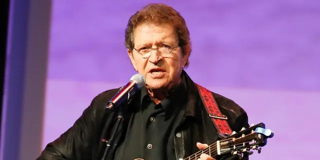 """FILE - Musician Mac Davis performs at the Texas Film Awards in Austin, Texas on March 6, 2014. Davis, a country star and Elvis songwriter, died on Tuesday, Sept. 29, 2020 after heart surgery. He was 78. Davis started his career writing hits for Presley, including """"A Little Less Conversation"""" and """"In the Ghetto."""" The Lubbock, Texas-native had a varied career over the years as a singer, actor and TV host and was inducted into the Songwriters Hall of Fame in 2006. He was named ACM entertainer of the year in 1974 after the success of songs like """"Baby Don't Get Hooked on Me."""""""