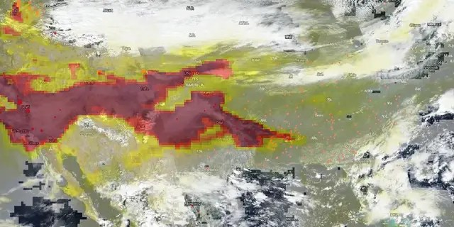 The OMPS (Ozone Mapper and Profiler Suite) on NASA and NOAA's Suomi NPP satellite was used to provide this image of the aerosols released from the burning fires which has traveled east.