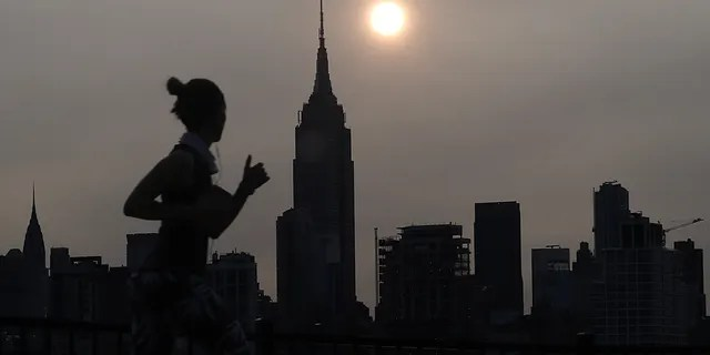 Sunrise behind the Empire State Building in New York City Tuesday morning in a haze created by smoke from the West Coast wildfires reaching the East Coast of the U.S.