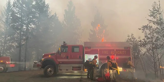 This photo provided by the Unified Fire Authority shows Utah fire crews prepare to fight wildfires near Butte Falls in southern Oregon on Saturday, Sept. 12, 2020.