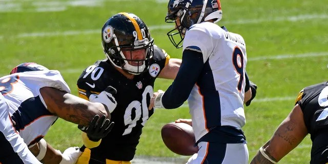 Pittsburgh Steelers outside linebacker T.J. Watt (90) sacks Denver Broncos quarterback Jeff Driskel (9) during the first half of an NFL football game in Pittsburgh, Sunday, Sept. 20, 2020. (AP Photo/Don Wright)