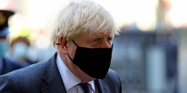 Britain's Prime Minister Boris Johnson arrives for a service to mark the 80th anniversary of the Battle of Britain at Westminster Abbey, London, Sunday, Sept. 20, 2020.