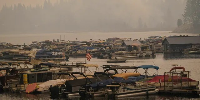 Smoke from the Creek Fire fills the air over a marina, Monday, Sept. 7, 2020, in Shaver Lake, Calif.