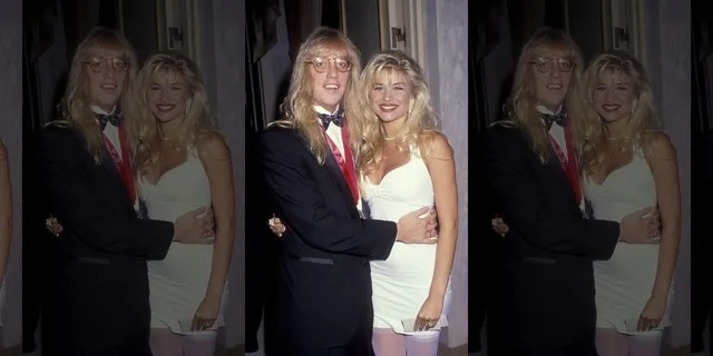 Jani Lane and Bobbie Brown attend BMI Awards Gala on May 21, 1991, at the Beverly Wilshire Hotel in Beverly Hills, California.