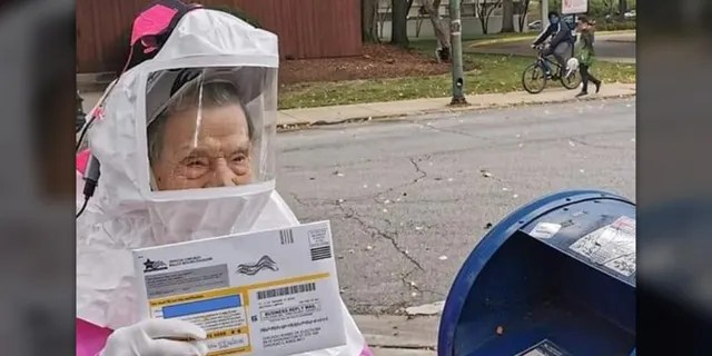 102-year-old CTU retiree Bea Lumpkin casting her vote-by-mail ballot.