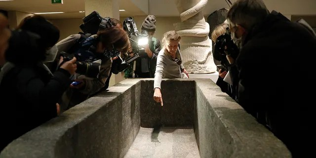 Friederike Seyfried, director of the Ancient Egyptian department, shows media a stain of the liquid inside a sarcopharg at the Egyptian Court of the Neue Museum in Berlin on Wednesday, October 21, 2020 (AP Photo / Markus Schreiber)