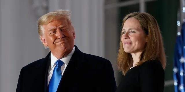 President Donald Trump and Amy Coney Barrett stand on the Blue Room Balcony after Supreme Court Justice Clarence Thomas administered the Constitutional Oath to her on the South Lawn of the White House in Washington, Monday, Oct. 26, 2020. Barrett and the two other Supreme Court justices Trump appointed during his four-year term are widely considered to be among his biggest accomplishments. (AP Photo/Patrick Semansky)