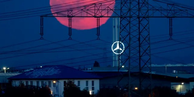 The full moon rises over the outskirts of Frankfurt, Germany, Saturday, Oct. 31, 2020. The full moon is known as a Blue moon. (Associated Press)