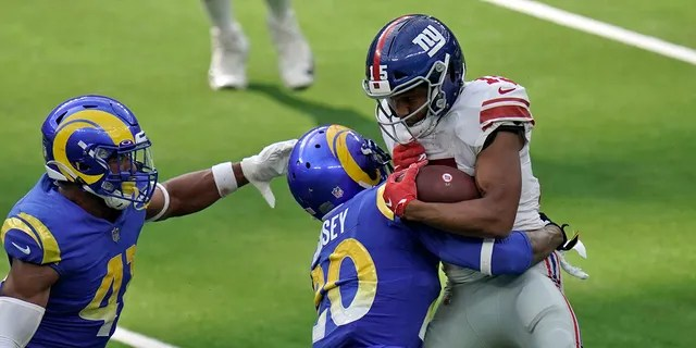 New York Giants wide receiver Golden Tate, right, is tackled by Los Angeles Rams cornerback Jalen Ramsey, center, during the second half of an NFL football game Sunday, Oct. 4, 2020, in Inglewood, Calif. (AP Photo/Jae C. Hong)