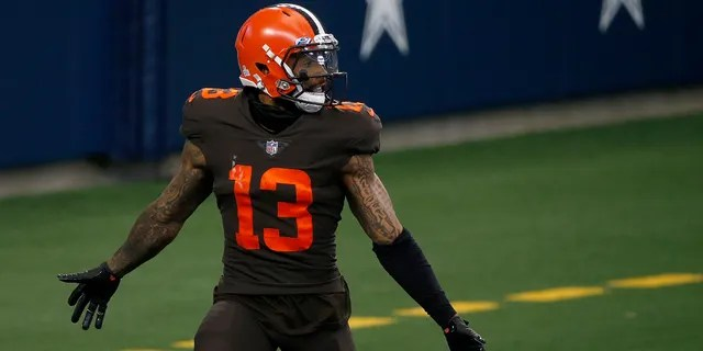 Cleveland Browns wide receiver Odell Beckham Jr. (13) celebrates after scoring a touchdown against the Dallas Cowboys late in the second half of an NFL football game in Arlington, Texas, Sunday, Oct. 4, 2020. (AP Photo/Michael Ainsworth)
