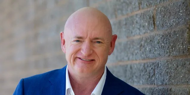 Democratic challenger Mark Kelly, for the U.S. Senate race against Republican incumbent Martha McSally, poses for a photo outside of the Udall Park Main Recreation Center, Tuesday, Sept. 29, 2020. (Mamta Popat/Arizona Daily Star via AP)
