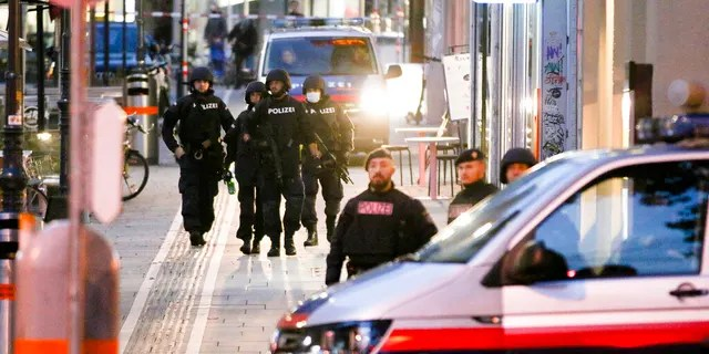 Following gunfire on people enjoying a last evening out before lockdown, police patrol at the scene in Vienna early Tuesday. (Photo/Ronald Zak)
