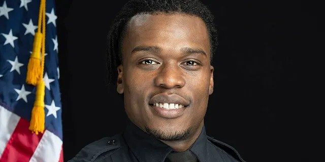 Wauwatosa Police Officer Joseph Mensah, a suburban Milwaukee cop who has fatally shot three people in the line of duty since 2015, including a Black teenager outside a mall in February 2020, is resigning from the department. The Wauwatosa Common Council approved a separation agreement with Mensah Tuesday night, Nov. 17 effective Nov. 30. (Gary Monreal/Monreal Photography LLC/Wauwatosa Police Department via AP)