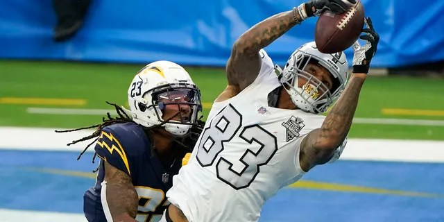 Las Vegas Raiders tight end Darren Waller (83) hauls in a touchdown pass as Los Angeles Chargers strong safety Rayshawn Jenkins defends second half of an NFL football game Sunday, Nov. 8, 2020, in Inglewood, Calif. (AP Photo/Alex Gallardo)