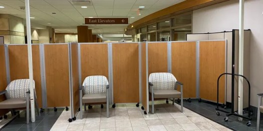 Booths separate patients in the waiting area.