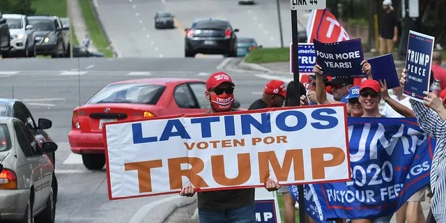 October 10, 2020 - Orlando, Florida, United States - People hold placards after U.S. Vice President Mike Pence addressed supporters at a Latinos for Trump campaign rally at Central Christian University on October 10, 2020 in Orlando, Florida. With 24 days until the 2020 presidential election, both Donald Trump and Democrat Joe Biden are courting the Latino vote as Latinos are the largest racial or ethnic minority in the electorate, with 32 million eligible voters. (Photo by Paul Hennessy/NurPhoto via Getty Images)