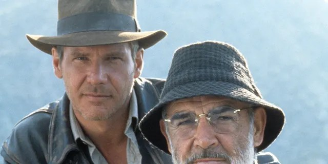 Harrison Ford and Sean Connery on the set of the film 'Indiana Jones And The Last Crusade', 1989. 