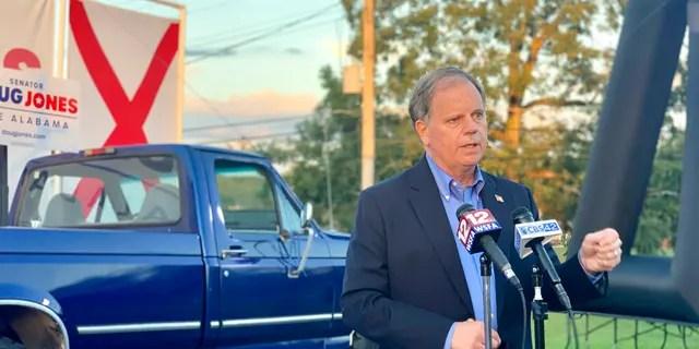 Democratic U.S. Sen. Doug Jones, of Alabama, speaks at a drive-in car rally in Troy, Ala., on Oct. 22, 2020. (Associated Press)