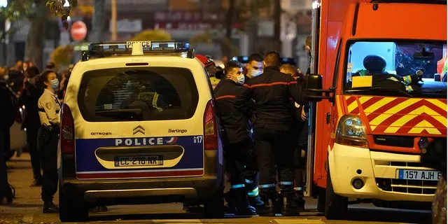 Police officers and rescue workers block the access to the scene after a Greek Orthodox priest was shot Saturday Oct.31, 2020 while he was closing his church in the city of Lyon, central France. (Associated Press)
