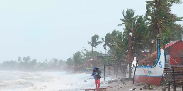 Strong waves batter the coast of Sorsogon province, central Philippines as a typhoon locally known as Goni hits the country on Sunday, Nov. 1, 2020. (Associated Press)